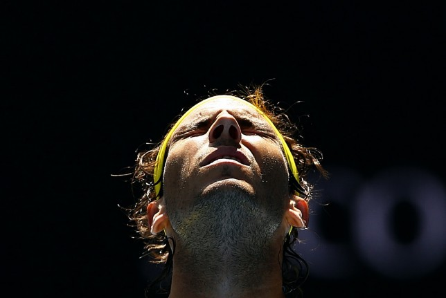 Spain's Rafael Nadal reacts during his first round match against Spain's Fernando Verdasco at the Australian Open tennis tournament at Melbourne Park, Australia, January 19, 2016. REUTERS/Thomas Peter       TPX IMAGES OF THE DAY