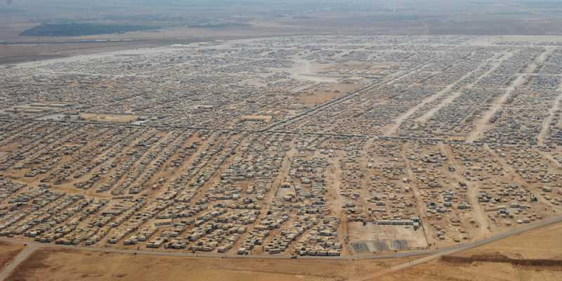 An aerial view shows the Zaatari refugee camp on July 18, 2013 near the Jordanian city of Mafraq, some 8 kilometers from the Jordanian-Syrian border. The northern Jordanian Zaatari refugee camp is home to 115,000 Syrians. AFP PHOTO/MANDEL NGAN/POOL